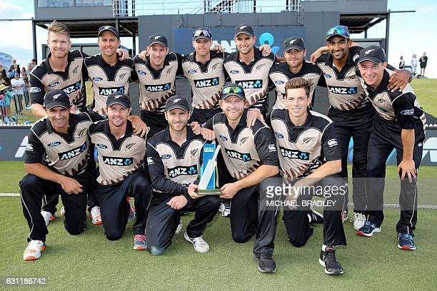 New Zealand players celebrate winning the series after the 20/20 International cricket match between New Zealand and Bangladesh at Bay Oval in Mount...