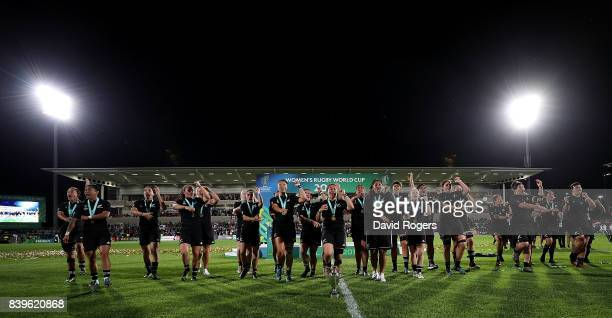 New Zealand players celebrate with the trophy following the Women's Rugby World Cup 2017 Final between England and New Zealand on August 26, 2017 in...