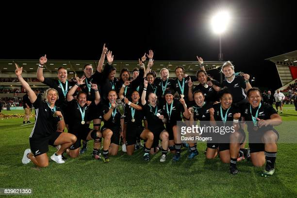 New Zealand players celebrate with the trophy following the Women's Rugby World Cup 2017 Final between England and New Zealand on August 26 2017 in...