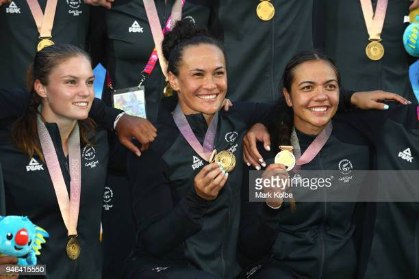 New Zealand players celebrate with their gold medals following the Women's Gold Medal Rugby Sevens Match between Australia and New Zealand on day 11...