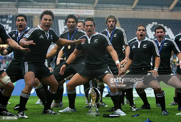 New Zealand players do the 'Haka' infront of the trophy after their 38-3 defeat of England at the IRB Junior World Championship Final game between...