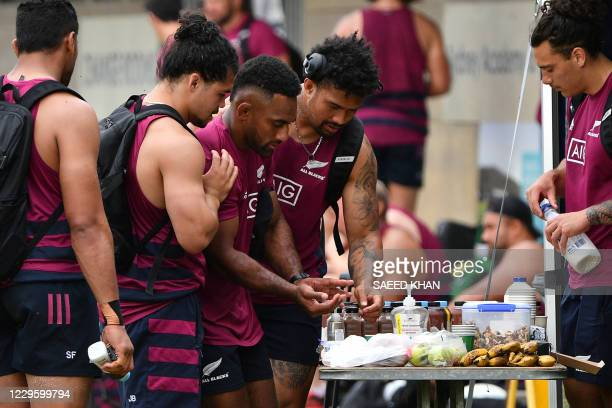 New Zealand players enjoy refreshments after the captain's run training session at Narrabeen Academy of Sport in Sydney on November 13 ahead of the...