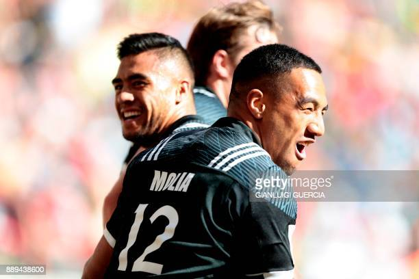 New Zealand players including Sione Molia celebrate after beating South Africa to reach the final after their semifinal match on the second day of...