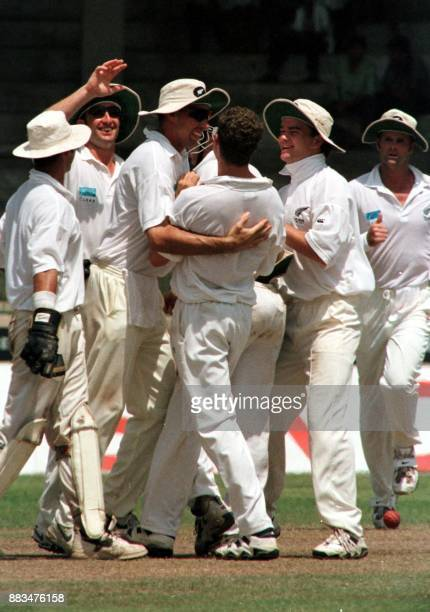 New Zealand players led by skipper Stephen Fleming pats bowler Paul Wiseman who took the wicket of Mahela Jayewardena 31 May on the fifth and final...