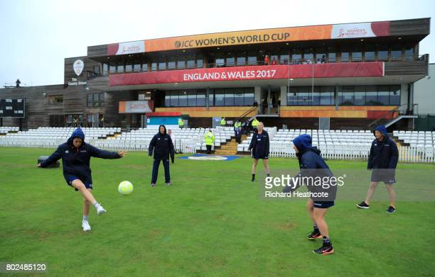 New Zealand players pass the time by playing football as rain delays the start of the ICC Women's World Cup group match between South Africa and New...