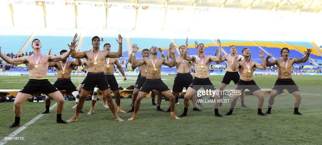 TOPSHOT - New Zealand players perform the haka after defeating Fiji in the men's rugby sevens gold medal match at the Robina Stadium during the 2018 Gold Coast Commonwealth Games on the Gold Coast on April 15, 2018. /