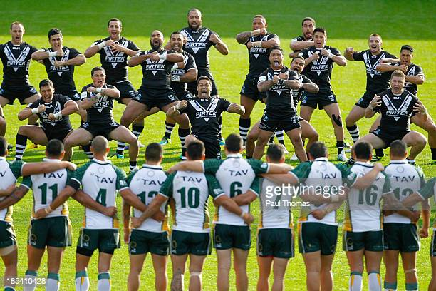New Zealand players perform the Haka before the World Cup warmup game between New Zealand and the Cook Islands at the Keepmoat Stadium on October 20...