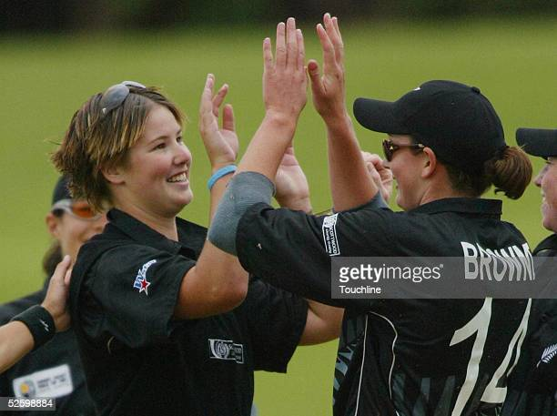 New Zealand players Rebecca Steele and Nicola Browne celebrate the wicket of Anjum Chopra of India during the IWCC Women's World Cup SemiFinal...