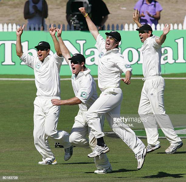 New Zealand players Ross Taylor Jamie How Mathew Sinclair and Stephen Fleming celebrate after the final wicket of England's Monty Panesar is taken...