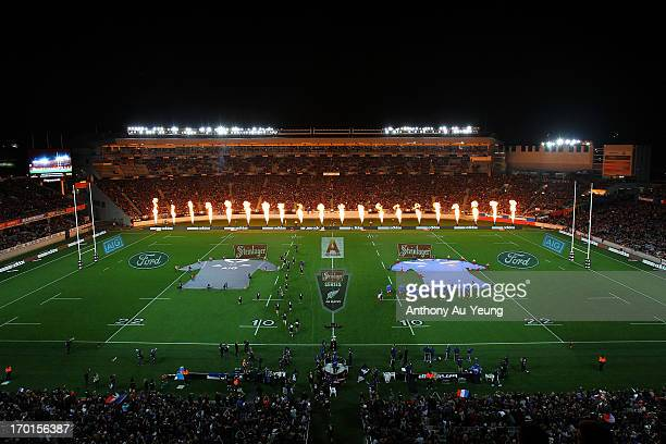 New Zealand players run on to the field before the first test match between the New Zealand All Blacks and France at Eden Park on June 8 2013 in...