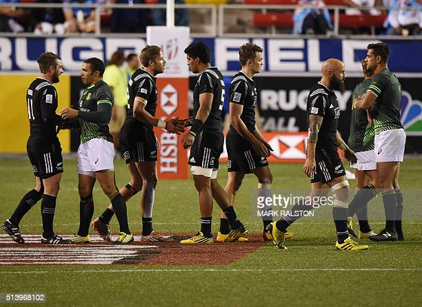 New Zealand players shake hands after their quarterfinal defeat by South African players during day two of the Men's 2016 USA Sevens Rugby Tournament...
