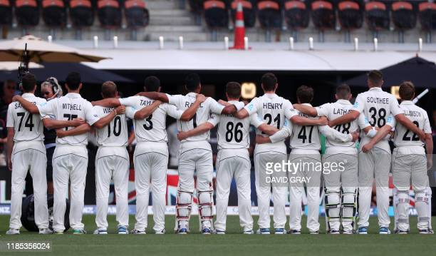 New Zealand players sing national anthem on day one of the second cricket Test match between England and New Zealand at Seddon Park in Hamilton on...