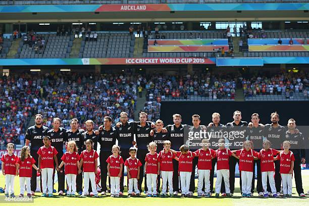 New Zealand players sing their national anthem during the 2015 ICC Cricket World Cup match between Australia and New Zealand at Eden Park on February...