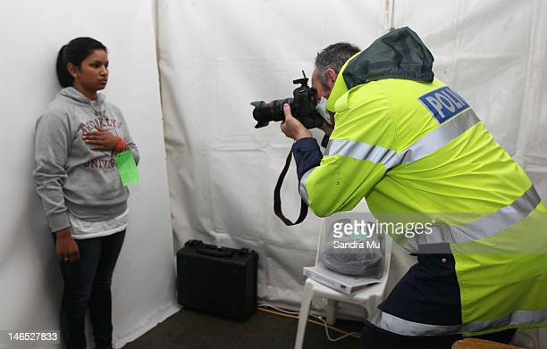 New Zealand Police photograph a potential illegal immigrant during a simulated mass arrival of asylum seekers at Devonport's Naval Base on June 19...