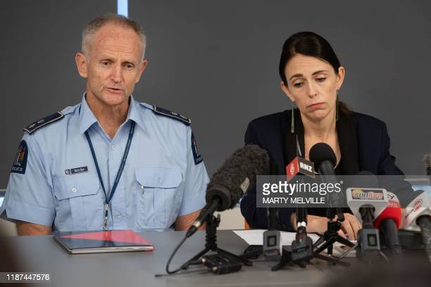 New Zealand Police Superintendent Bruce Bird with Prime Minister of New Zealand Jacinda Ardern speak to the media about the eruption of...