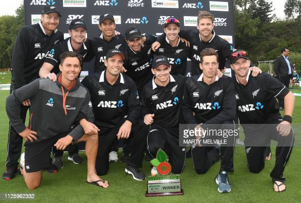 New Zealand pose for a team photo as they celebrate their series win following the third oneday international cricket match between New Zealand and...