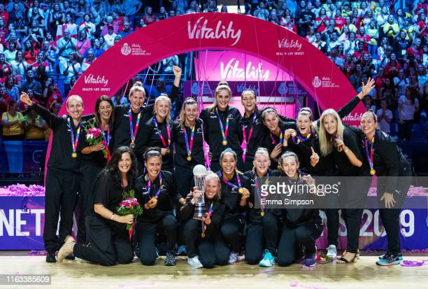 New Zealand pose for photo after lifting the Vitality Netball World Cup 2019 winners trophy at MS Bank Arena on July 21 2019 in Liverpool England