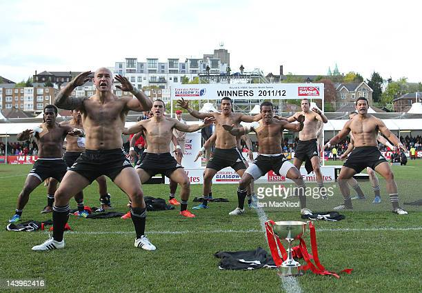New Zealand preform the Haka with the trophy after defeating England during the match between New Zealand and England during day two of the IRB...