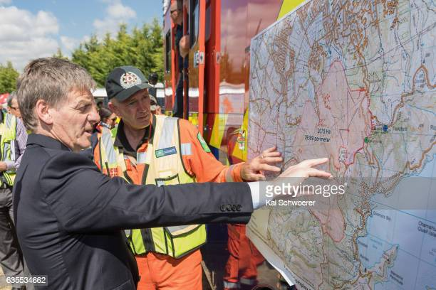 New Zealand Prime Minister Bill English looks at a map showing the fires on February 16 2017 in Christchurch New Zealand A state of emergency has...