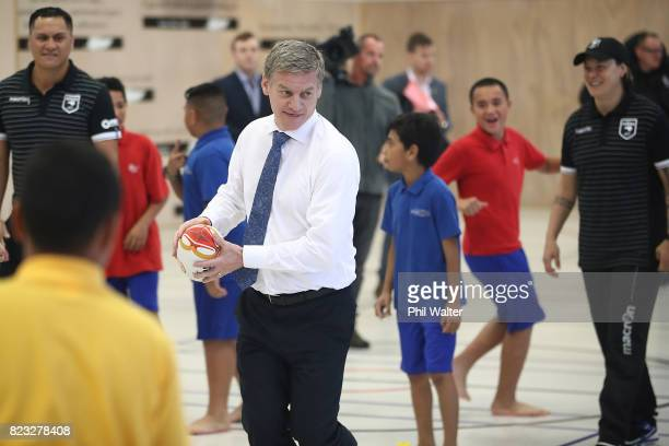 New Zealand Prime Minister Bill English passes a ball at Redoubt Primary School during a Rugby League World Cup promotion event on July 27 2017 in...