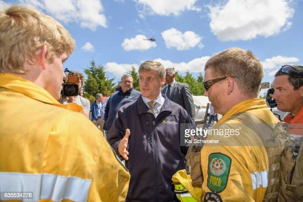 New Zealand Prime Minister Bill English speaks to firefighters on February 16 2017 in Christchurch New Zealand A state of emergency has been declared...