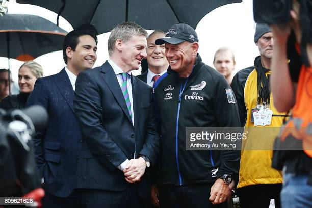 New Zealand Prime Minister Bill English speaks to Grant Dalton CEO of Emirates Team New Zealand during the Team New Zealand Americas Cup Welcome Home...