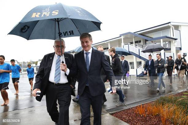 New Zealand Prime Minister Bill English walks with Sir Peter Leitch at Redoubt Primary School during a Rugby League World Cup promotion event on July...