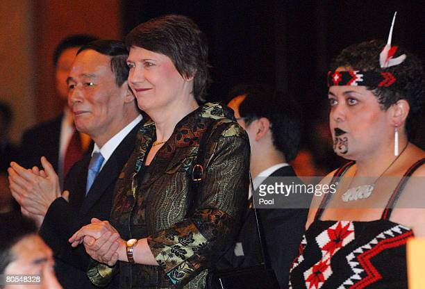 New Zealand Prime Minister Helen Clark and Chinese Vice Premier Wang Qishan watch a traditional New Zealand performance at the celebration party for...