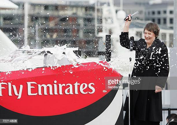 New Zealand Prime Minister Helen Clark cuts the ribbon on the champagne to christen the bow of the new NZL 92 boat during the Team New Zealand...