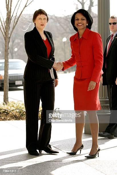 New Zealand Prime Minister Helen Clark greets US Secretary of State Condoleezza Rice outside the Blair House March 20 2007 in Washington DC Clark is...