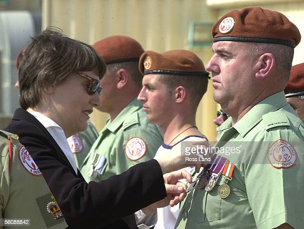 New Zealand Prime Minister Helen Clark presents Warrant Officer Stanley Sole with his New Zealnd operational Service Medal during a ceremony at the...