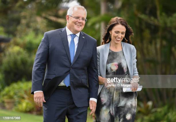 New Zealand Prime Minister, Jacinda Ardern and Australian Prime Minster, Scott Morrison share some laughter walking across a lawn to a press...