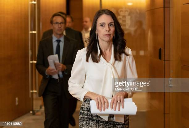 New Zealand Prime Minister Jacinda Ardern and Director-General of Health Ashley Bloomfield arrive for the post-Cabinet media conference at Parliament...
