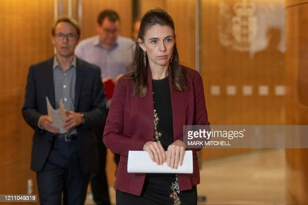 New Zealand Prime Minister Jacinda Ardern and DirectorGeneral of Health Ashley Bloomfield arrive for their Covid19 update media conference at...