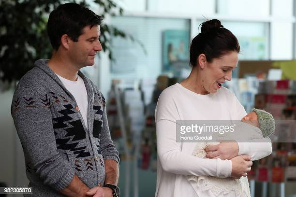 New Zealand Prime Minister Jacinda Ardern and her partern Clarke Gayford pose for a photo with their new baby girl Neve Te Aroha Ardern Gayford June...