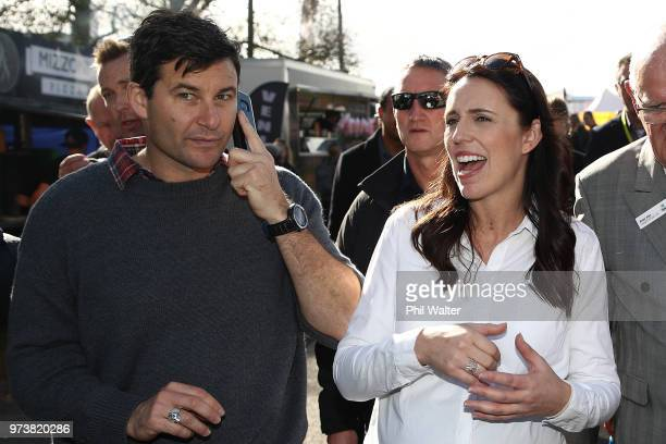 New Zealand Prime Minister Jacinda Ardern and her partner Clarke Gayford take a walk around the Fieldays in Mystery Creek on June 14 2018 in Hamilton...