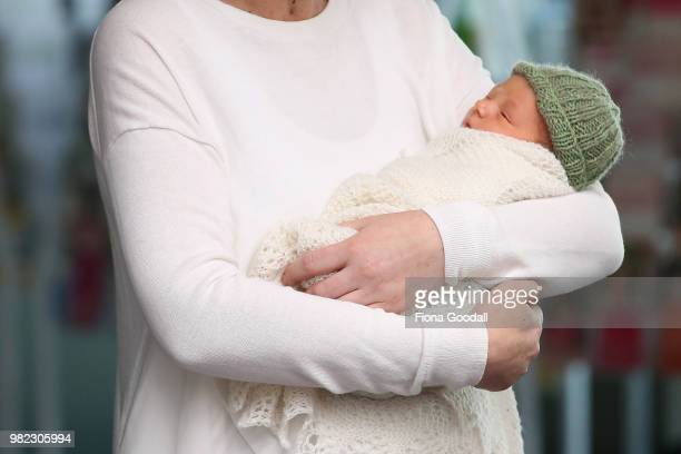 New Zealand Prime Minister Jacinda Ardern and her partner Clarke Gayford pose for a photo with their new baby girl Neve Te Aroha Ardern Gayford June...