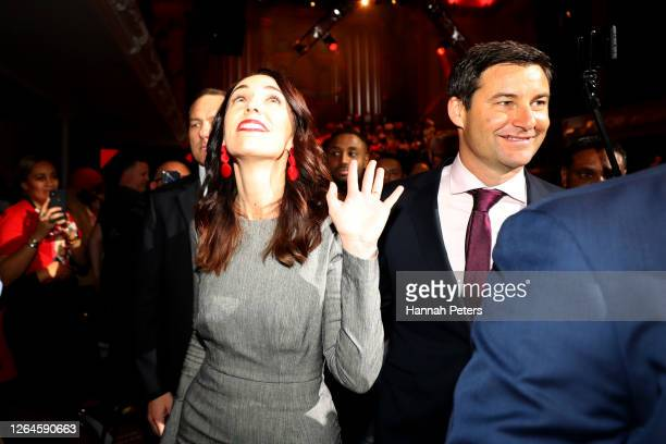 New Zealand Prime Minister Jacinda Ardern and partner Clarke Gayford walk through the crowd at the Labour Party 2020 election campaign launch on...