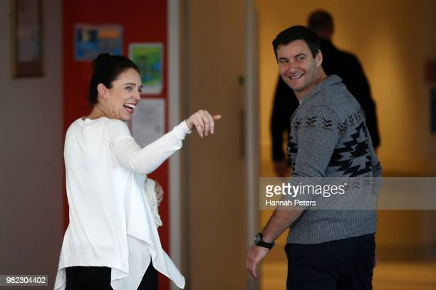 New Zealand Prime Minister Jacinda Ardern and partner Clarke Gayford pose for a photo with their new baby girl Neve Te Aroha ArdernGayford on June 24...