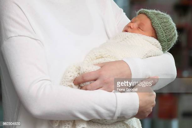 New Zealand Prime Minister Jacinda Ardern and partner Clarke Gayford pose for a photo with their new baby girl Neve Te Aroha Ardern Gayford June 24...