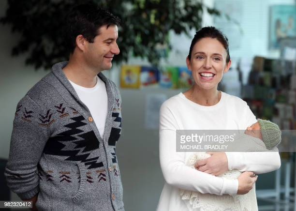 New Zealand Prime Minister Jacinda Ardern and partner Clarke Gayford pose with their baby daugther Neve Te Aroha Ardern Gayford outside the hospital...