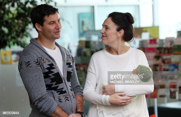 TOPSHOT New Zealand Prime Minister Jacinda Ardern and partner Clarke Gayford pose with their baby daugther Neve Te Aroha Ardern Gayford outside the...