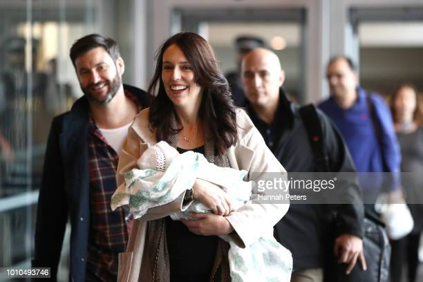 New Zealand Prime Minister Jacinda Ardern arrives at Wellington Airport with her partner Clarke Gayford and their daughter Neve Gayford on August 4,...