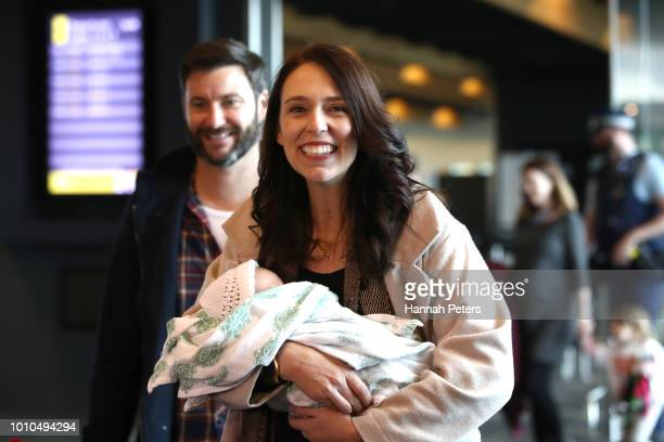 New Zealand Prime Minister Jacinda Ardern arrives at Wellington Airport with her partner Clarke Gayford and their daughter Neve Gayford on August 4...