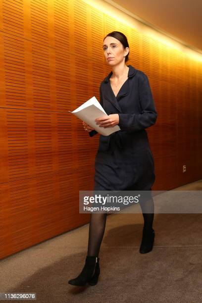 New Zealand Prime Minister Jacinda Ardern arrives for a press conference at Parliament on March 17 2019 in Wellington New Zealand 50 people are...