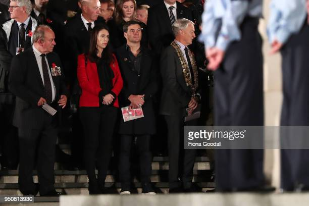 New Zealand Prime Minister Jacinda Ardern (CL and partner Clarke Gayford with Auckland Mayor Phil Goff attend the Anzac Day ceremony at Auckland War...