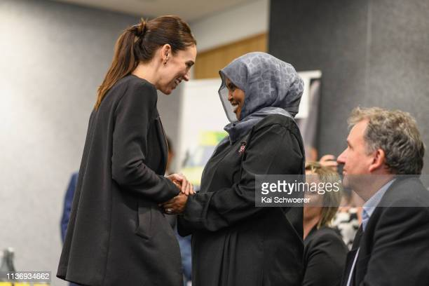New Zealand Prime Minister Jacinda Ardern greets a first responder during a visit at the Justice and Emergency Services precinct on March 20 2019 in...