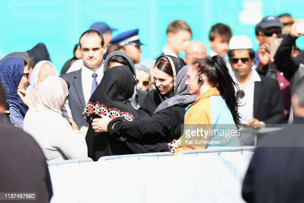 New Zealand Prime Minister Jacinda Ardern greets members of the Muslim community as she attends islamic prayers in Hagley Park near Al Noor mosque on...