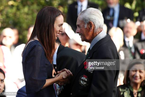 New Zealand Prime Minister Jacinda Ardern greets Robert Bom Gillies one of only two surviving members of the Maori Battalion at the opening of Te Rau...