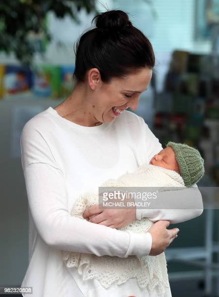 New Zealand Prime Minister Jacinda Ardern holds her baby daugther Neve Te Aroha Ardern Gayford outside the hospital in Auckland on June 24 2018...